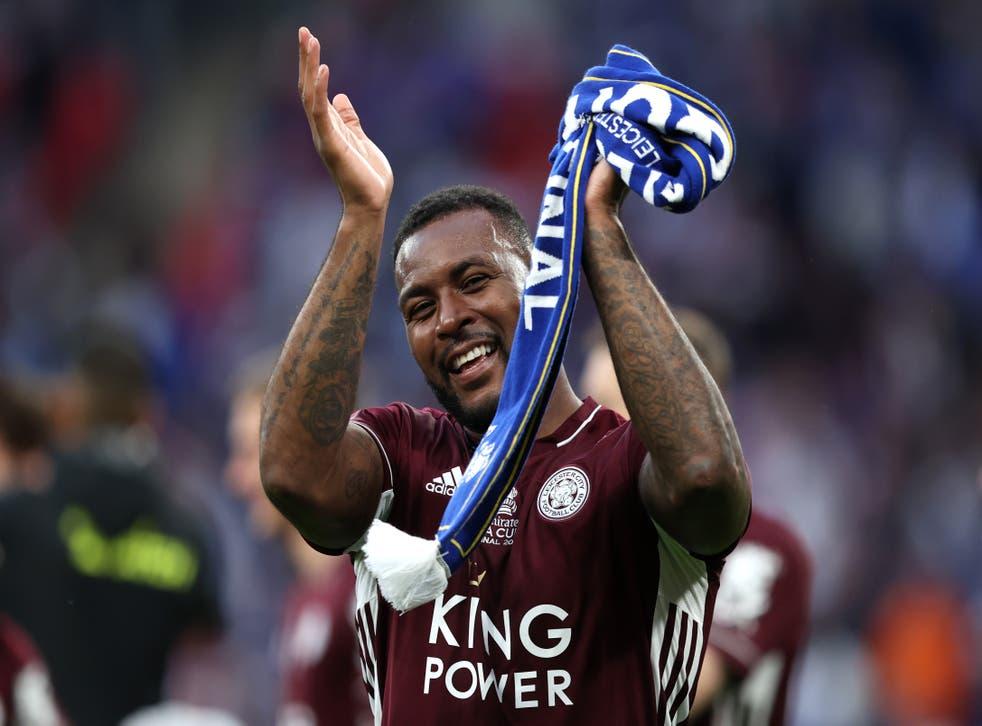 Wes Morgan celebrates with Leicester supporters at Wembley