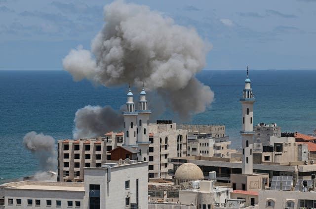 <p>Smoke billows from the the area around the port of Gaza City following Israeli bombardment from the sea on May 17</p>