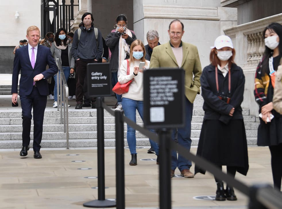 Dowden (left) joins gallery-goers this morning at London's National Gallery