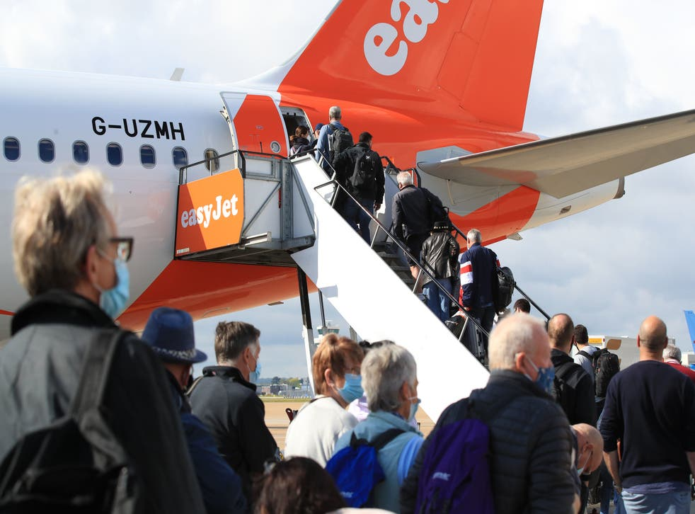<p>Passengers at Gatwick prepare to board an easyJet flight to Faro, Portugal, on Monday</p>