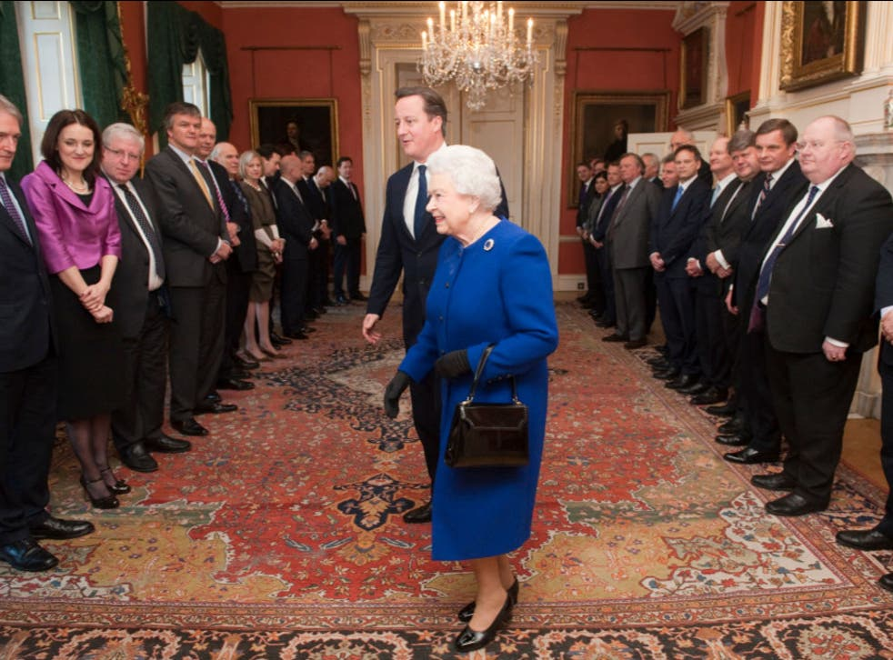 Queen Elizabeth II arrives with British Prime Minister David Cameron to meet members of the cabinet at Number 10 Downing Street as she attends the Government's weekly Cabinet meeting on December 2012 in London