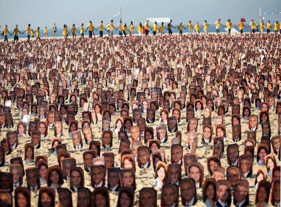 Members of the Baha'i religion demonstrate in Rio de Janeiro's Copacabana beach