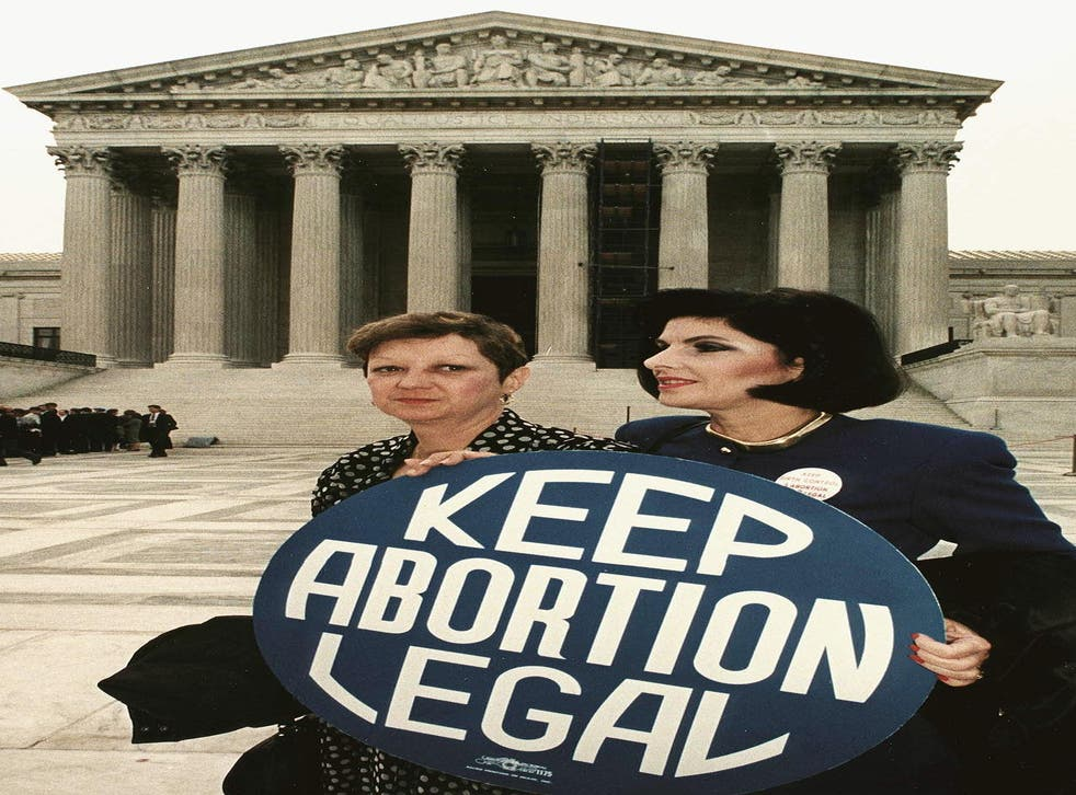 """<p>This April 26, 1989 file photo shows Norma McCorvey (L), known as """"Jane Roe"""" in the 1973 landmark Roe vs Wade ruling that expanded abortion rights in the US, holding a pro-choice sign with attorney Gloria Allred (R) in front of the US Supreme Court building prior to attending arguments on an abortion case in Washington, DC. </p>"""