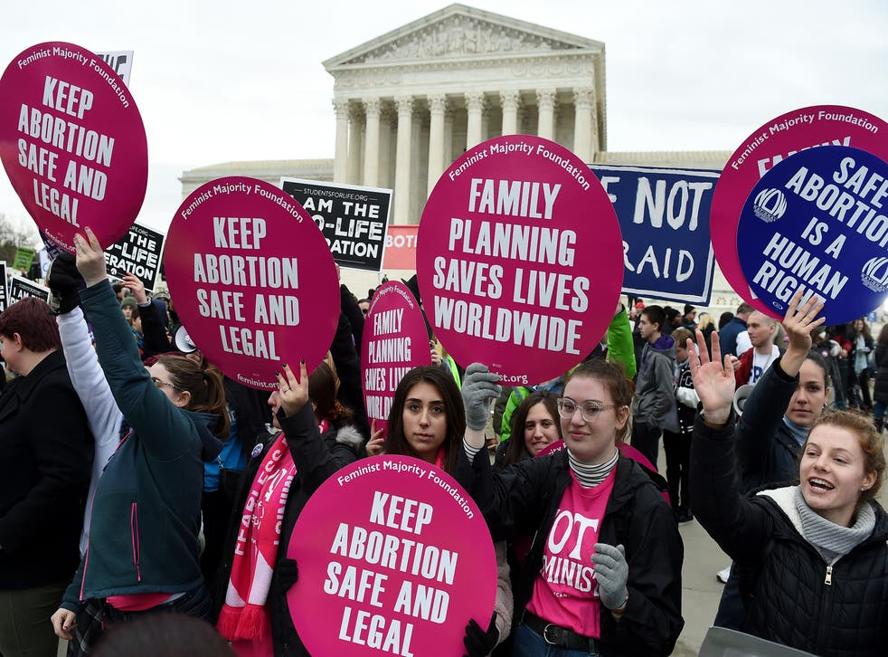 Pro-choice and pro-life activists demonstrate in front of the the US Supreme Court