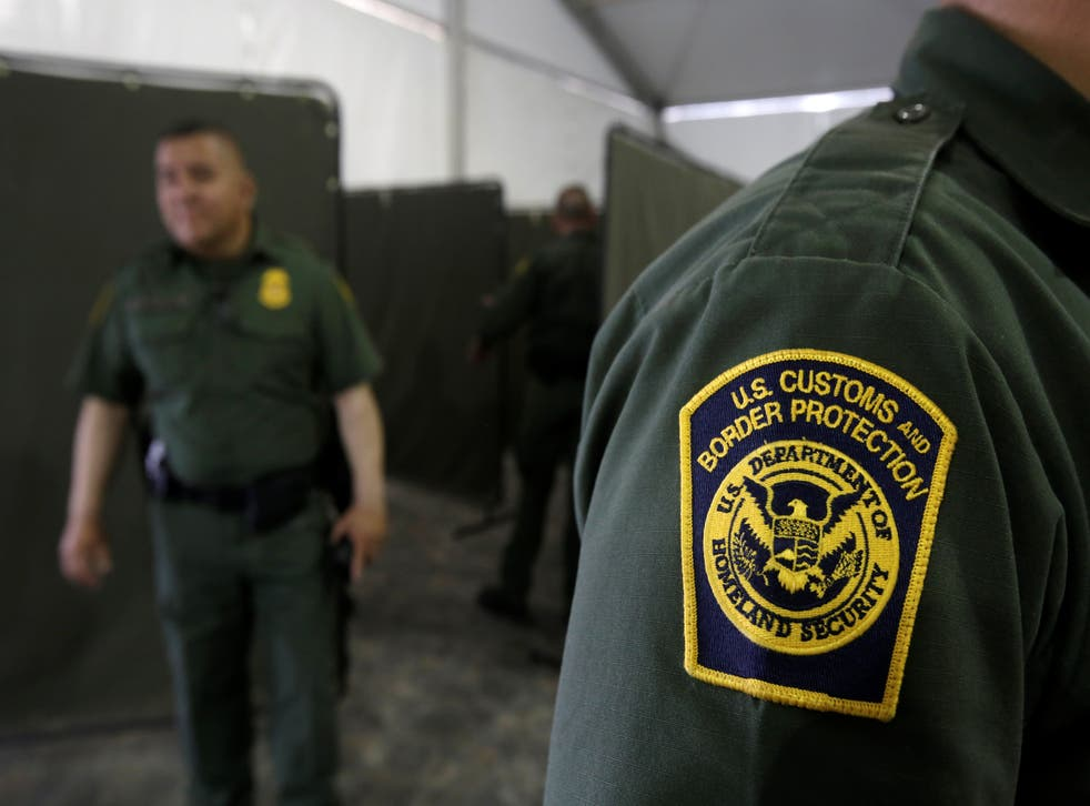 US Border Patrol agents are seen during a tour of US Customs and Border Protection (CBP) temporary holding facilities in El Paso, Texas, in May 2019