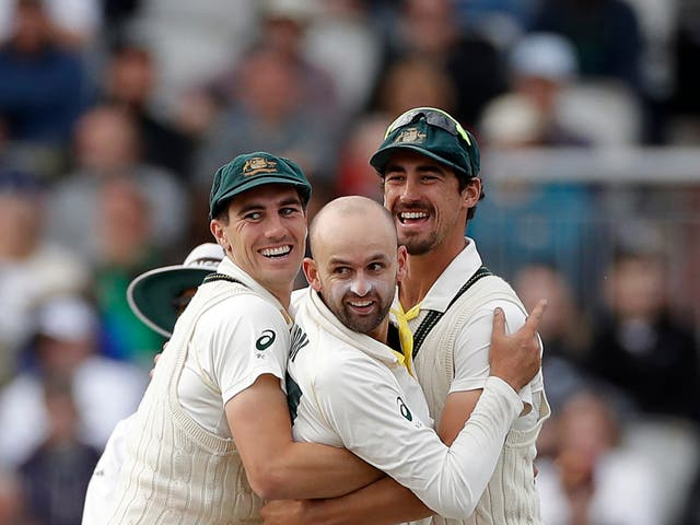 Australia bowlers Pat Cummins, Nathan Lyon and Mitchell Starc (L-R) celebrate