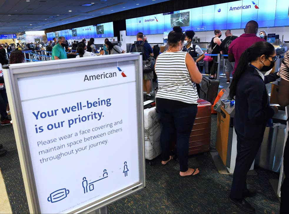 <p>Passengers waiting in line for an American Airlines flight </p>