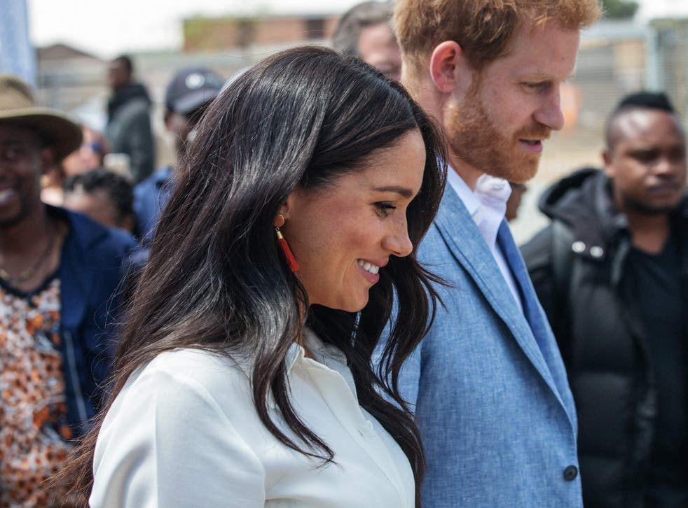 Prince Harry and Meghan leave the Youth Employment Services Hub in Tembisa township, Johannesburg