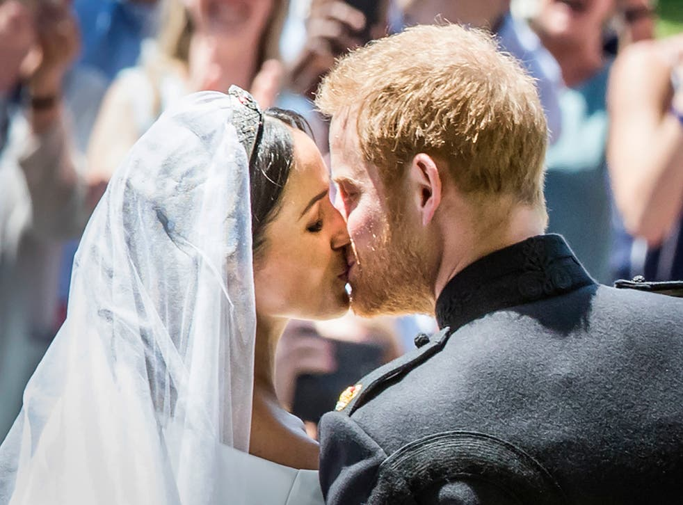 Britain's Prince Harry, Duke of Sussex kisses his wife Meghan, Duchess of Sussex