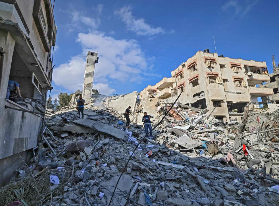 <p>A six-storey building in Gaza City after it was destroyed in an Israeli airstrike</p>