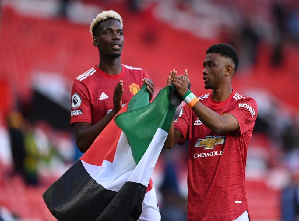 <p>Paul Pogba and Amad Diallo held up the Palestine flag at full-time</p>
