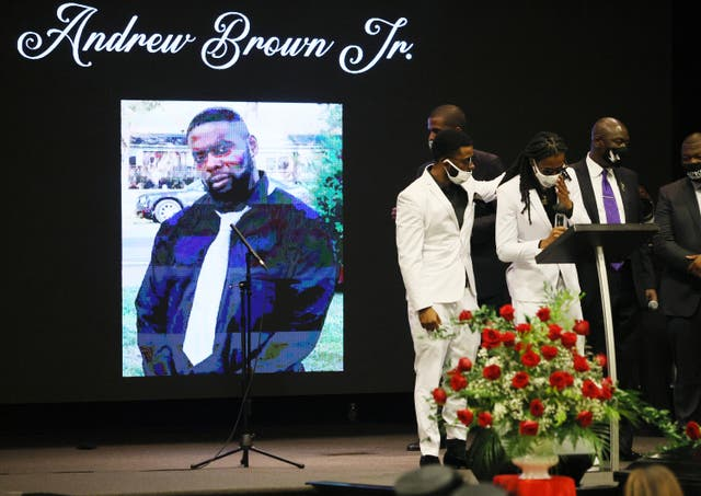 <p>ELIZABETH CITY, NORTH CAROLINA - MAY 03: Jha'rod Ferebee (L) and Khalil Ferebee speak during the funeral for their father Andrew Brown Jr. at the Fountain of Life church on May 03, 2021 in Elizabeth City, North Carolina. Mr. Brown was shot to death by Pasquotank County Sheriff's deputies on April 21.  </p>