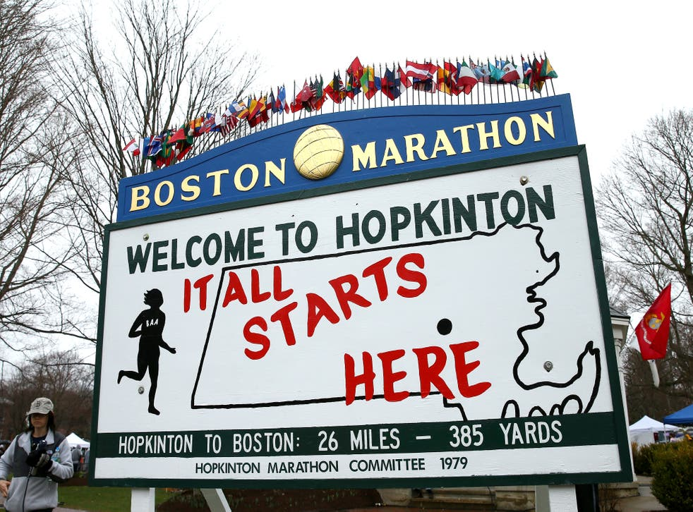 """<p> A view of a sign stating """"It All Starts Here"""" near the start of the Boston marathaon in Hopkinton, Masachusetts, where a teen girl was found dead, hanging from a tree last month.  </p>"""