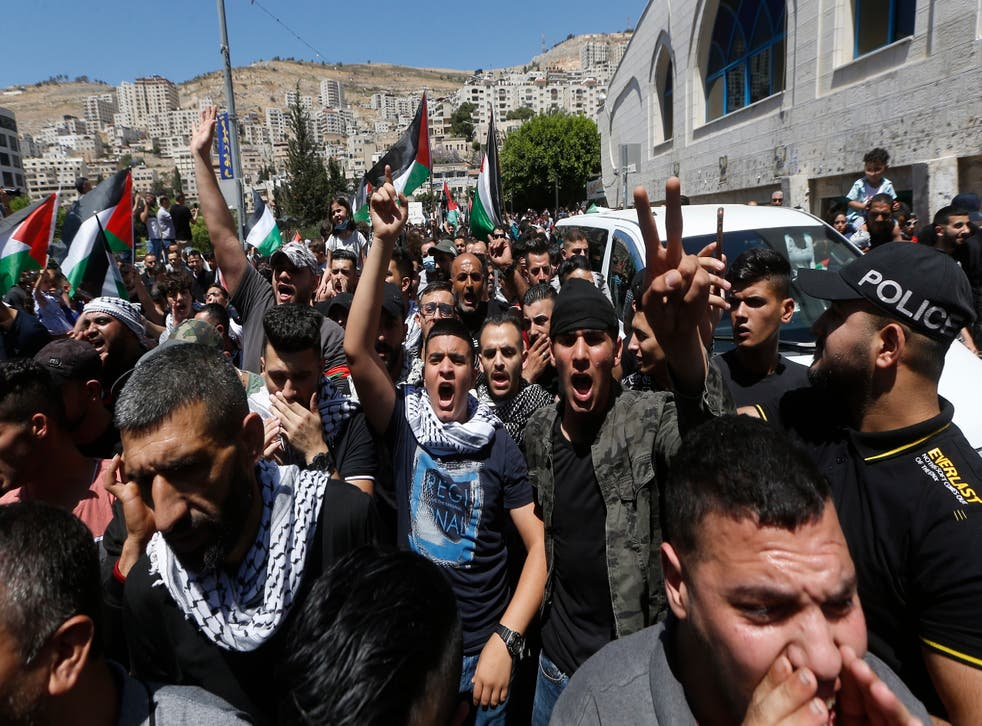 Palestinian protesters shout slogans against Israel during a rally to support Gaza in the West Bank City of Nablus