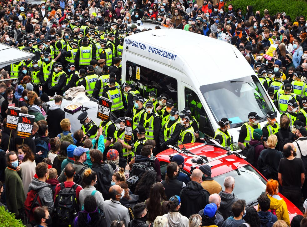 <p>Protesters in Glasgow stop removal of two asylum seekers earlier in May</p>