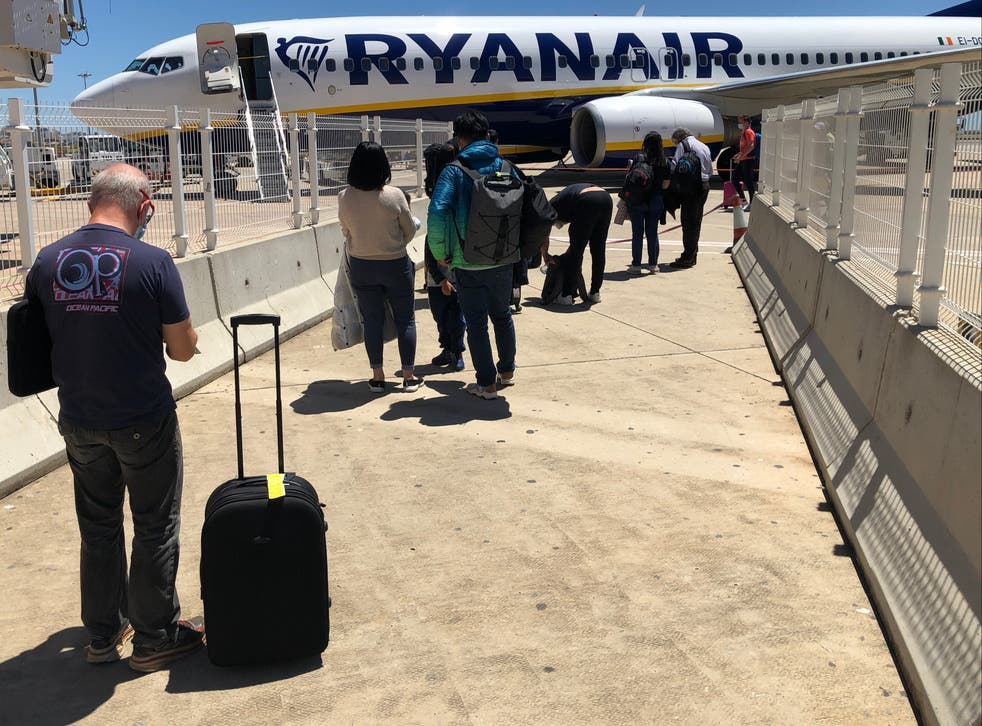 Waiting game: passengers at Faro airport queuing for a flight to London Stansted