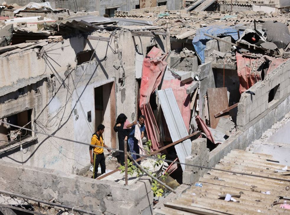 <p>Palestinians check the aftermath of Israeli airstrikes in Rafah in the southern Gaza Strip </p>