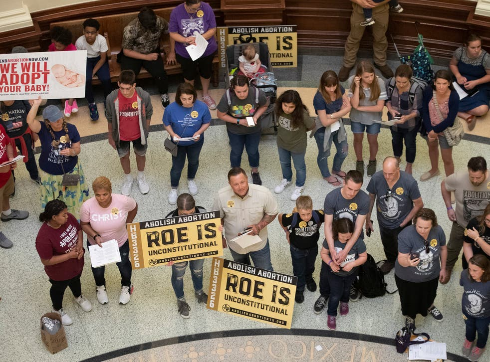 <p>Pro-life demonstrators gather in the rotunda at the Capitol while the Senate debated anti-abortion bills in Austin, Texas</p>