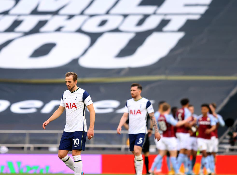 Wantaway Spurs striker Harry Kane (left) reacts to his side's loss to Villa