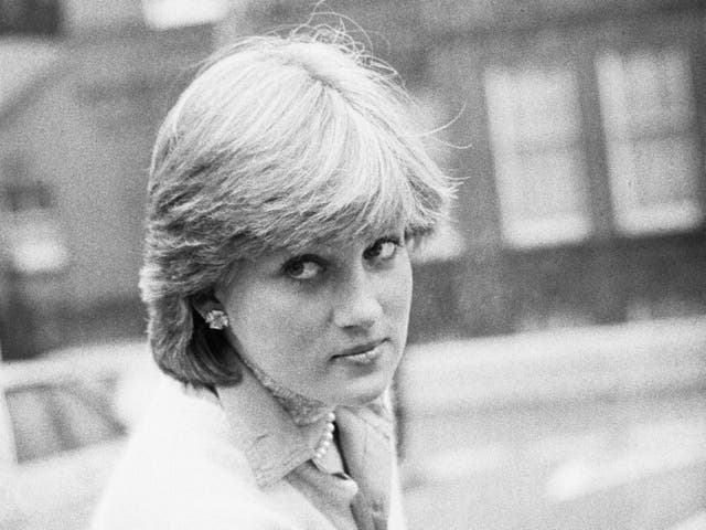 Lady Diana Spencer opens a car door as she holds her coat, London, UK, 13th November 1980.