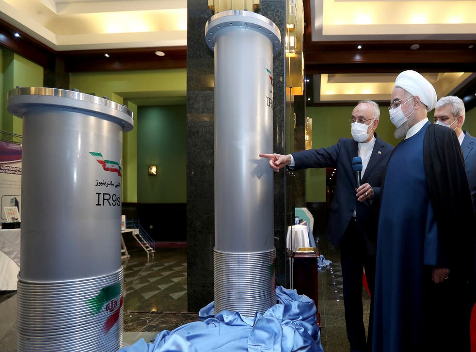 <p>Iranian president Hassan Rouhani (second right) visits an exhibition of Iran's nuclear achievements in Tehran</p>