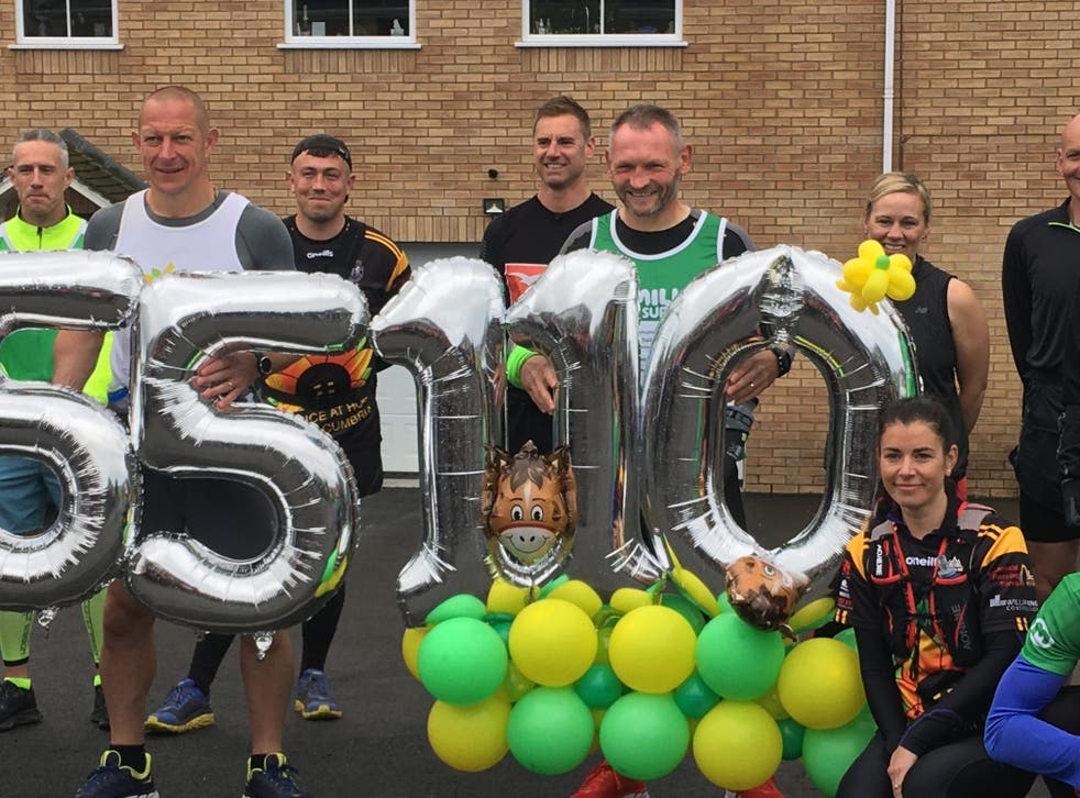Fundraiser Gary McKee with supporters before setting off on the final marathon of his 110-day challenge