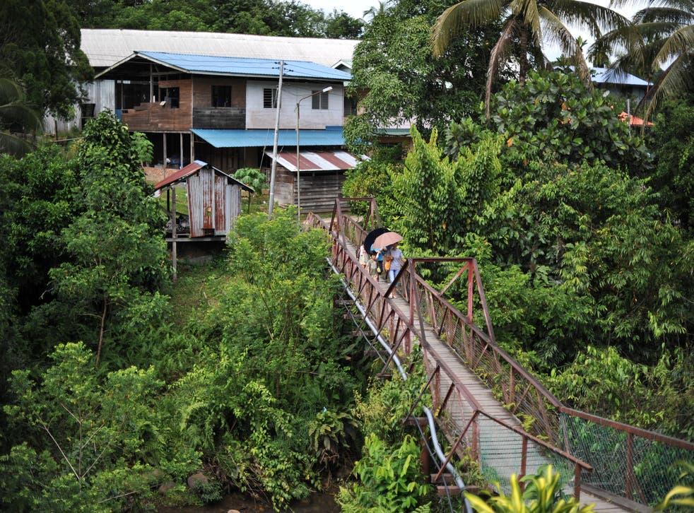 <p>File image: Villagers walk on a bridge in Malaysia's Sarawak state on Borneo island</p>