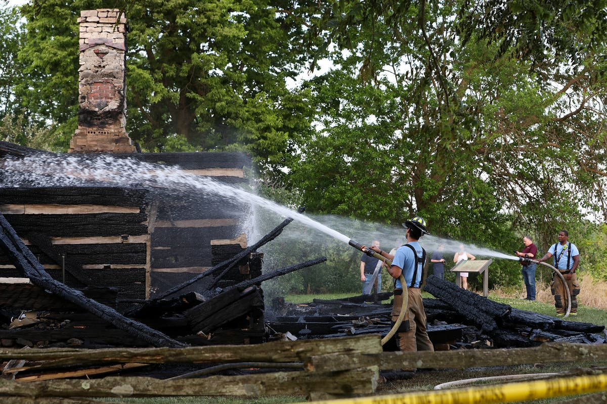 Suspect in court after fire destroys re-created cabin