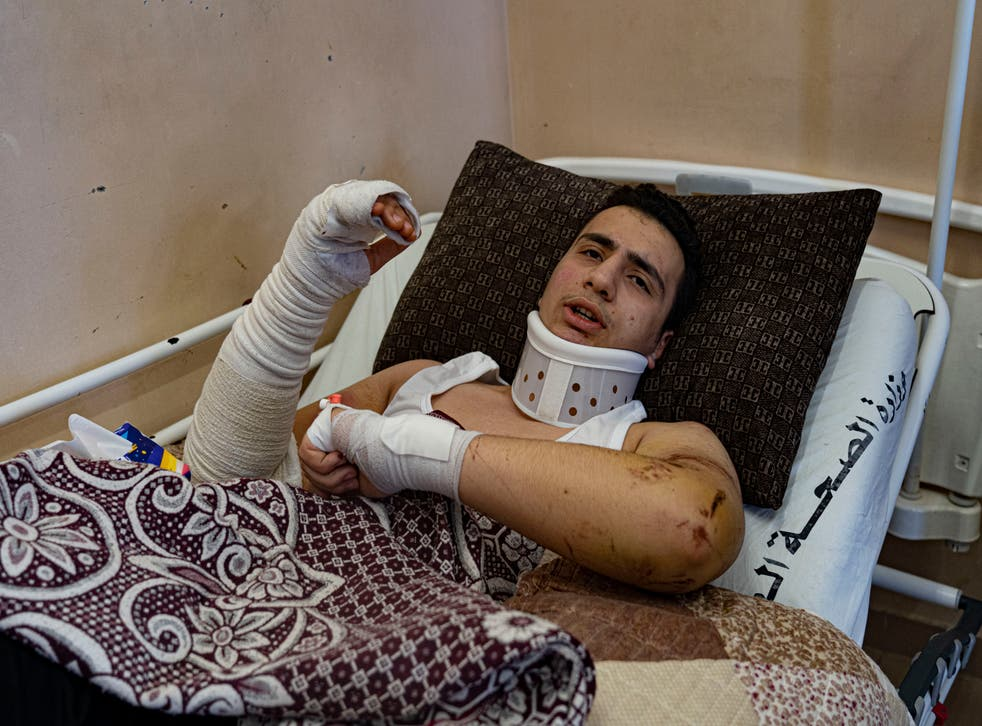 <p>Omar Abu al-Ouf: 'I tried to take my sister in my arms to protect her'</p>