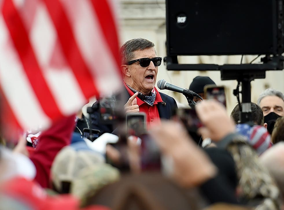 <p>Former US National Security Advisor Michael Flynn speaks to supporters of US President Donald Trump during the Million MAGA March to protest the outcome of the 2020 presidential election in front of the US Supreme Court on December 12, 2020 in Washington, DC. (</p>