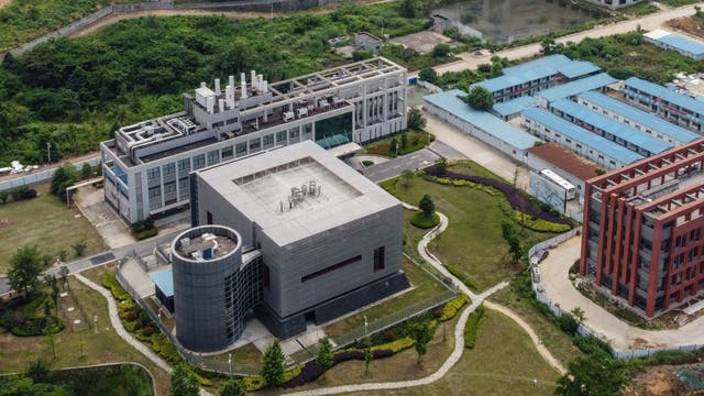 <p>This aerial view shows the P4 laboratory (L) on the campus of the Wuhan Institute of Virology in Wuhan in China's central Hubei province on May 27, 2020. </p>