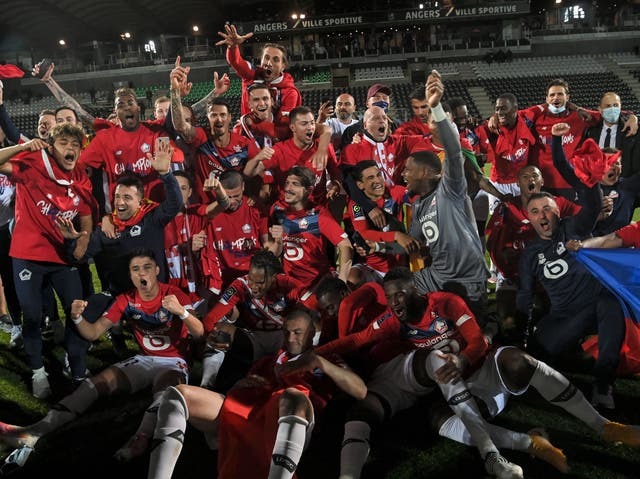 Lille players and staff celebrate their title triumph