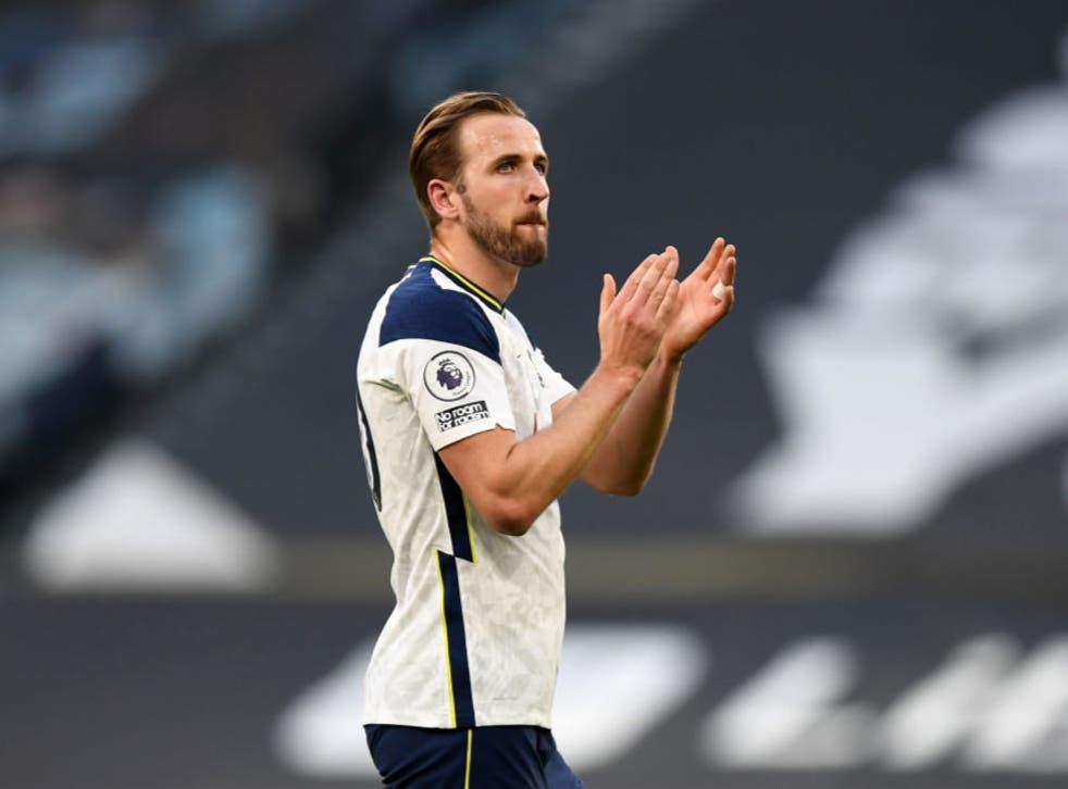 <p>Harry Kane applauds Tottenham's supporters</p>