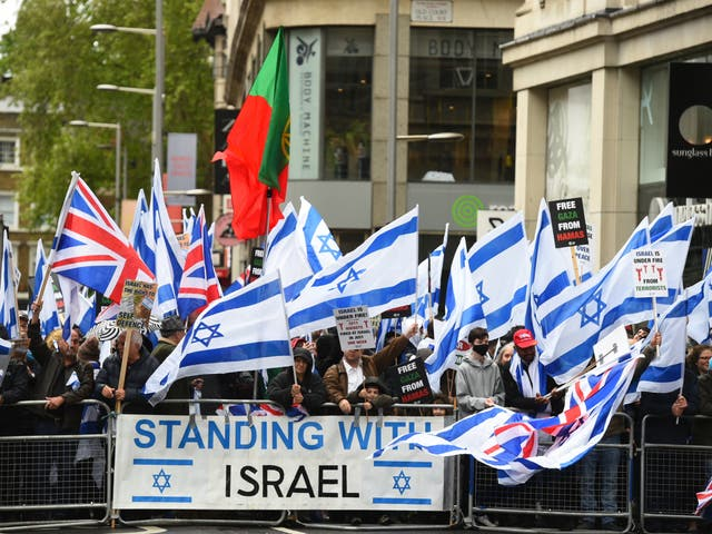 Hundreds of pro-Israel demonstrators gathered outside the Israeli embassy in London on Sunday for a rally