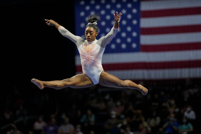 <p>Simone Biles performs her balance beam routine during the U.S. Classic gymnastics competition in Indianapolis</p>
