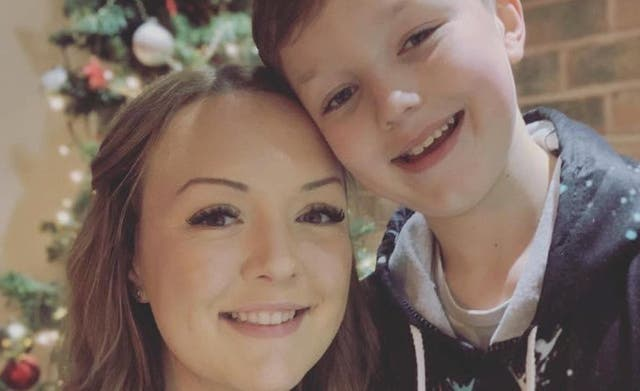 Amy Clarke and her 11-year-old son who remains in a critical condition