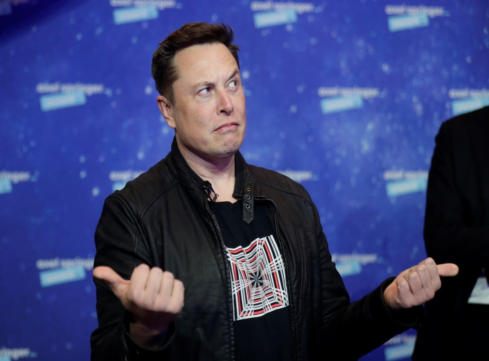 <p>SpaceX owner and Tesla CEO Elon Musk gestures as he arrives on the red carpet for the Axel Springer Awards ceremony, in Berlin</p>