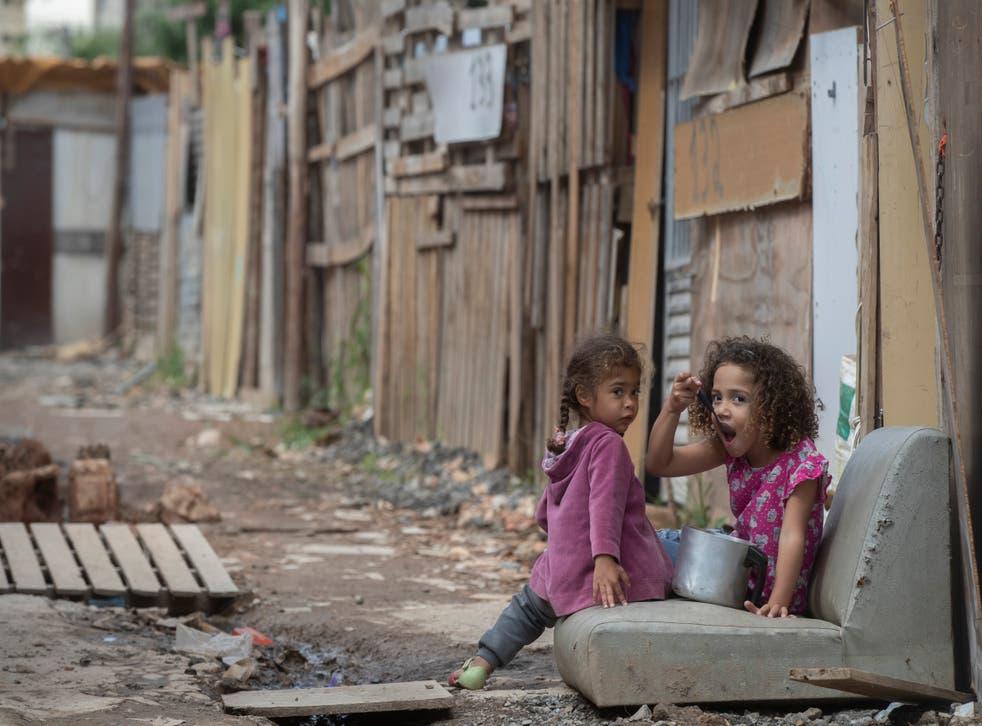 Virus Outbreak Brazil Poverty Comeback