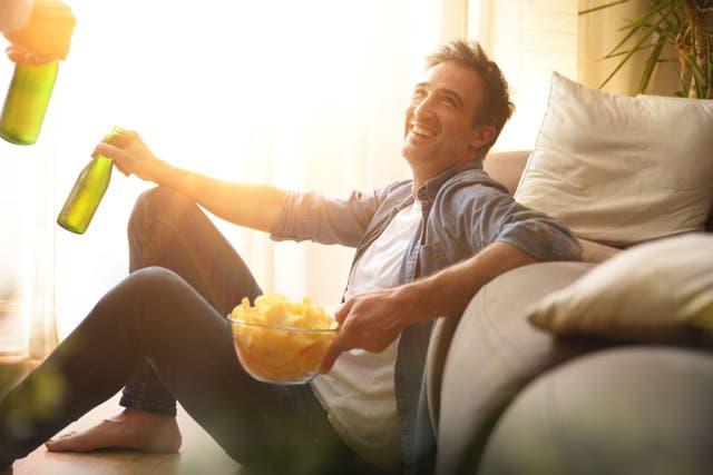Happy man with snacks
