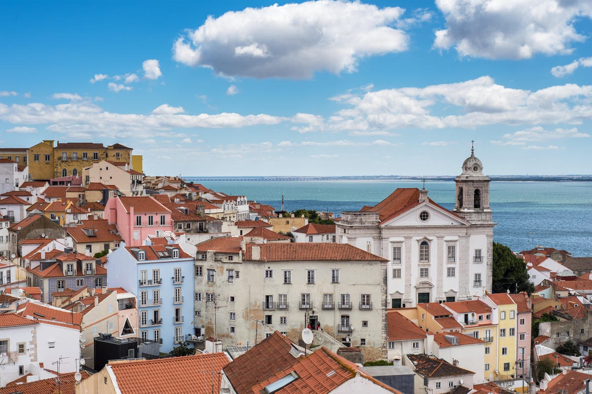Holidaymakers scramble to return home from Portugal – follow live