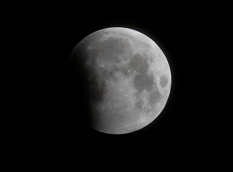 <p>The progression of the eclipse begins with a partial covering of the moon as seen in Santa Monica, California, on Wednesday 26 May 2021</p>