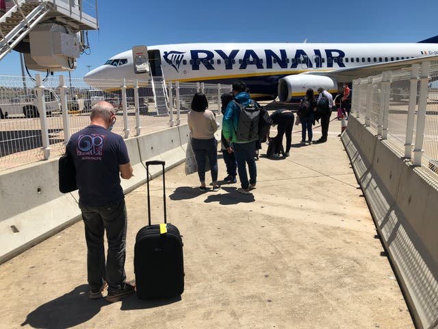Green channel: passengers at Faro airport in Portugal, the only major European country on the 'green list'