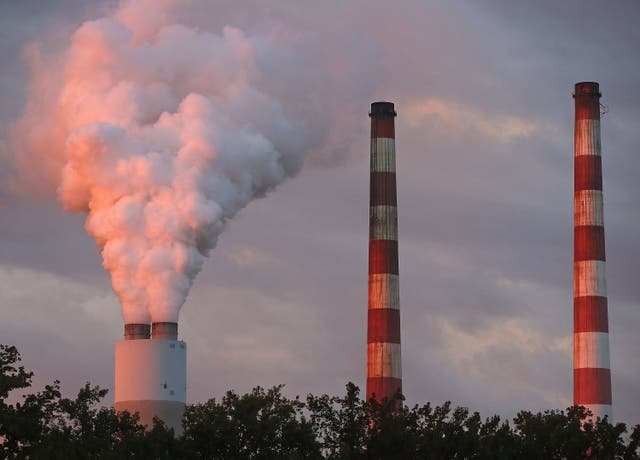 <p>Emissions spew out of a large stack at the coal-fired Morgantown Generating Station on October 10, 2017 in Newburg, Maryland.</p>
