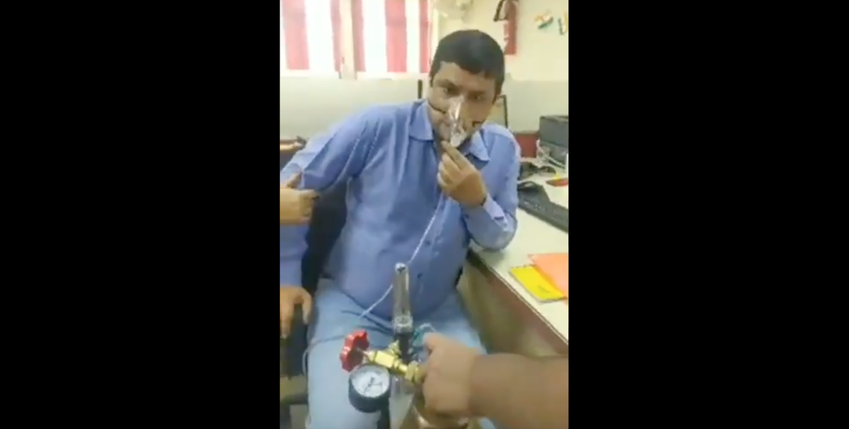 Denied leave after contracting Covid, Indian bank employee walks to work hooked up to oxygen tank
