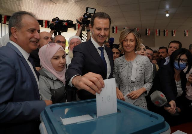 <p>Bashar Assad votes in Douma, Syria with his wife Asma </p>