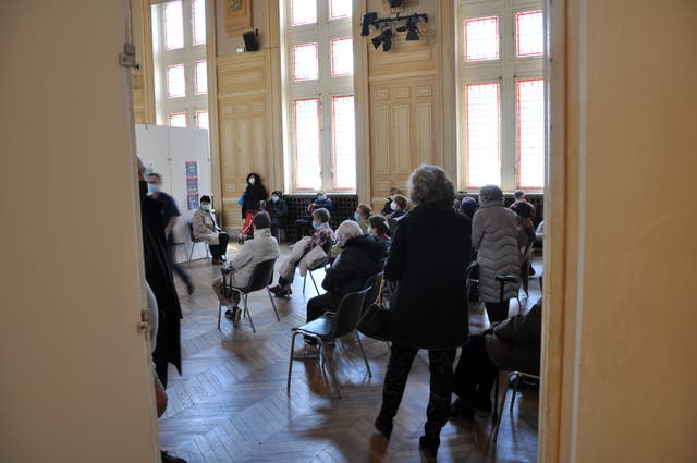 <p>Parisian residents waiting to get the jab at a vaccination centre in the 13th arrondissement</p>