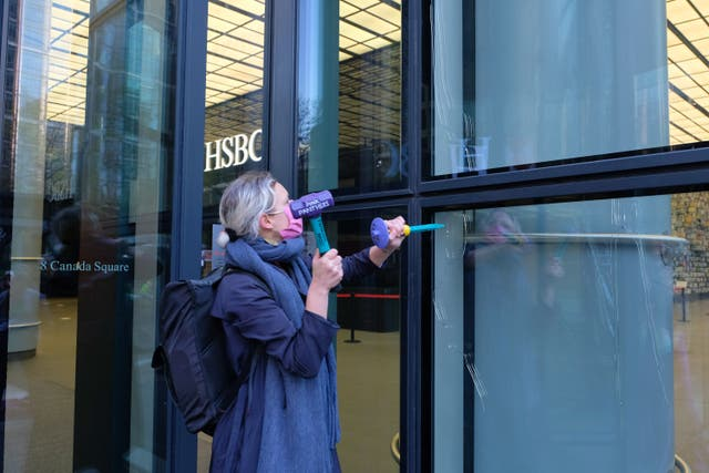An Extinction Rebellion protester outside a branch of HSBC