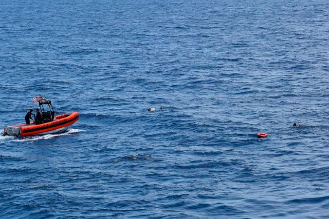 <p>A Coast Guard crew rescues eight people from the water approximately 16 miles south of Key West</p>