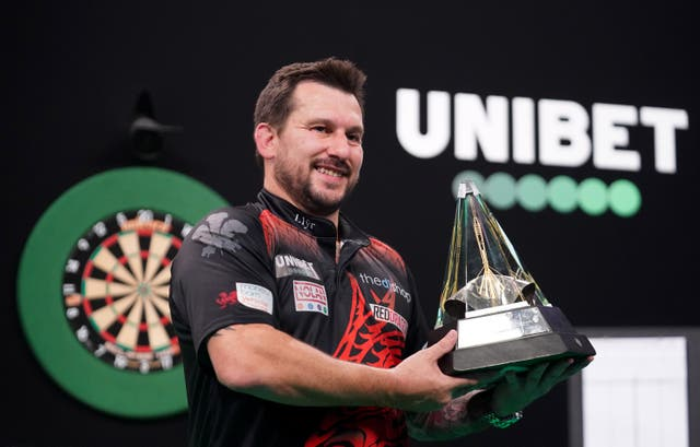 Jonny Clayton poses with the trophy after winning the Unibet Premier League final