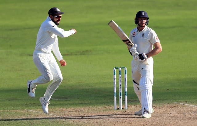 <p>India's Virat Kohli, left, celebrates the wicket of England's Jos Buttler</p>